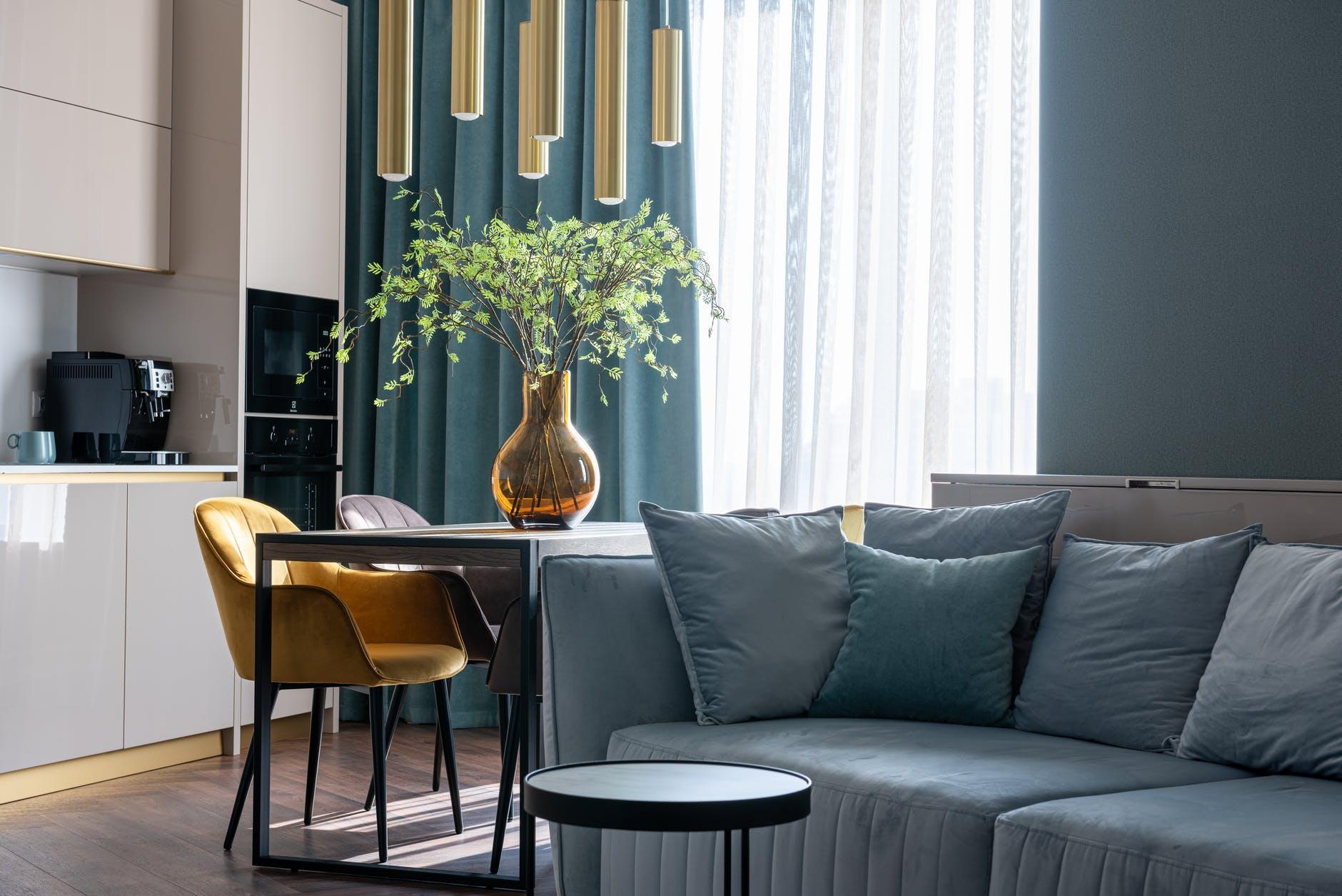 modern studio apartment interior with sofa and kitchen zone